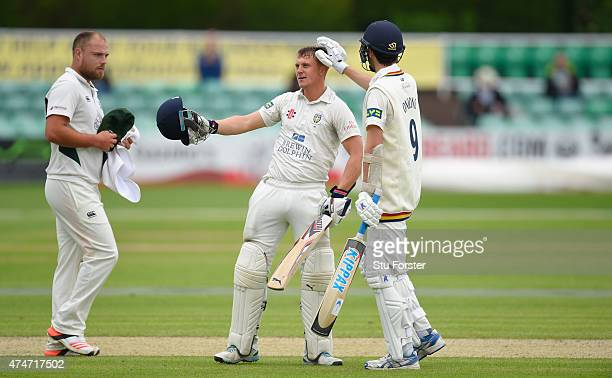 Durham batsman Scott Borthwick celebrates after reaching his century with Graham Onions whilst bowler Joe Leach looks on during day two of the LV...