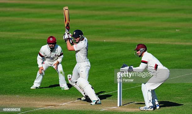 Durham batsman Scott Borthwick cuts a ball to the boundary watched by keeper Alex Barrow and fielder Johann Myburgh during day three of the LV County...