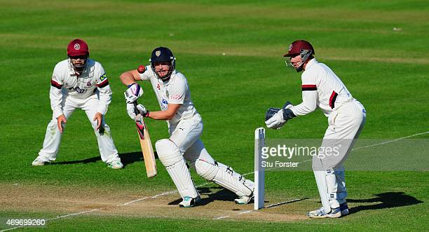 Durham batsman Scott Borthwick cuts a ball towards the boundary watched by keeper Alex Barrow and fielder Johann Myburgh during day three of the LV...