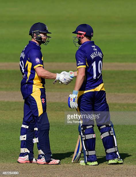 Durham batsmen Mark Stoneman and Phil Mustard congratulate each other on their 200 run opening partnership during the Royal London OneDay Cup match...