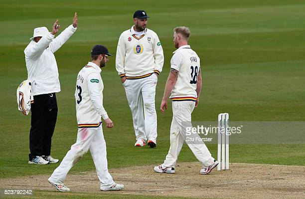 Durham bowler Ben Stokes looks on as umpire Graham Lloyd signals a six off his bowling during day one of the Specsavers County Championship Division...