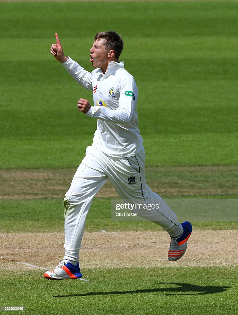 Durham bowler Brydon Carse celebrates after dismissing Warwickshire batsman Jonathan Trott during day three of the Specsavers County Championship Division One match between Warwickshire and Durham at Edgbaston on May 24, 2016 in Birmingham, United Kingdom.