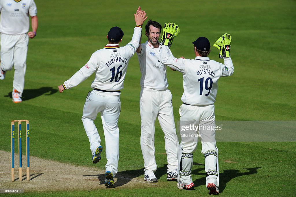 Durham bowler Graham Onions celebrates with team mates after taking the wicket of Notts batsman Michael Lumb during day two of the LV County...