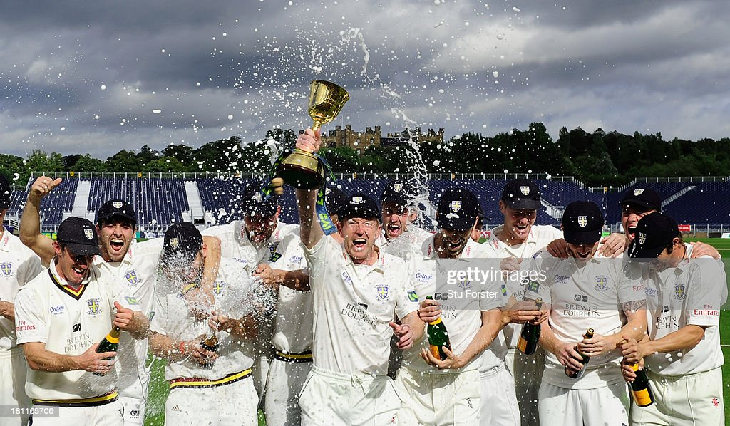 Durham captain Paul Collingwood and team celebrate with the trophy after winning the LV County Championship Division One title after day three of the...