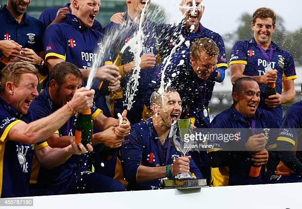 Durham celebrate with the trophy after defeating Warwickshire in the final during the Royal London OneDay Cup 2014 Final at Lord's Cricket Ground on...