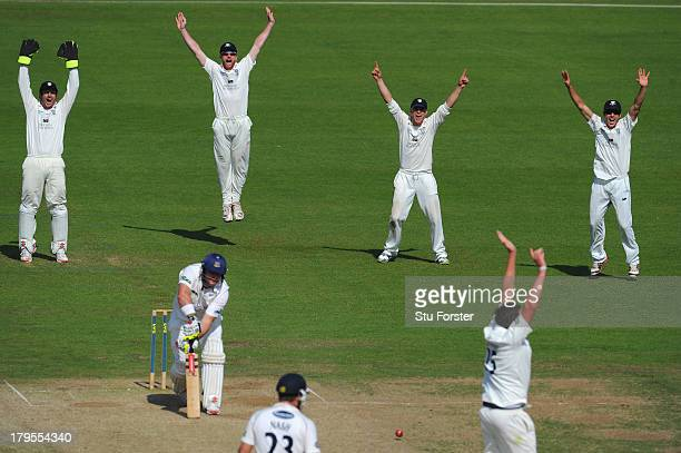 Durham fielders Phil Mustard Paul Collingwood Scott Borthwick Michael Richardson and bowler Mitchell Claydon appeal with success for the wicket of...