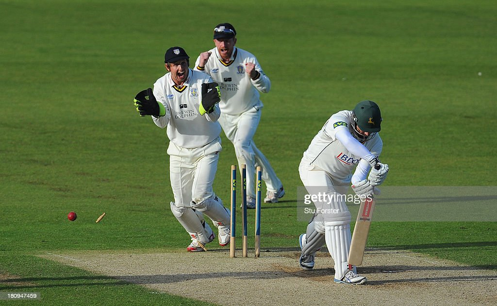 Durham players Phil Mustard and Paul Collingwood celebrate as Notts batsman Paul Franks is bowled by Scott Borthwick during day two of the LV County...