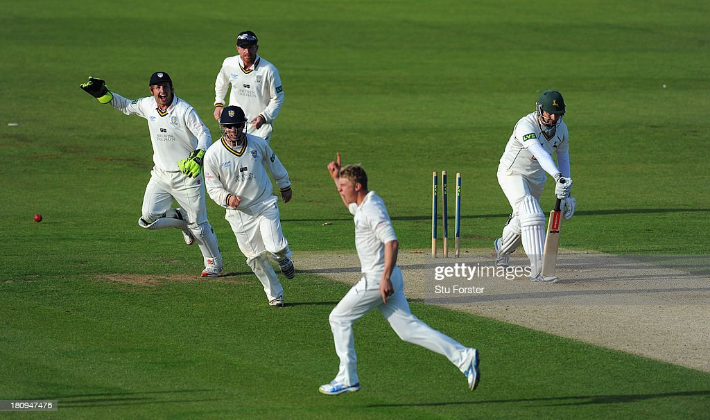 Durham players Will Smith Phil Mustard and Paul Collingwood celebrate as Notts batsman Paul Franks is bowled by Scott Borthwick during day two of the...