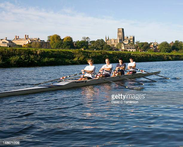 Durham University students rowing on River Wear, Durham Cathedral in background.
