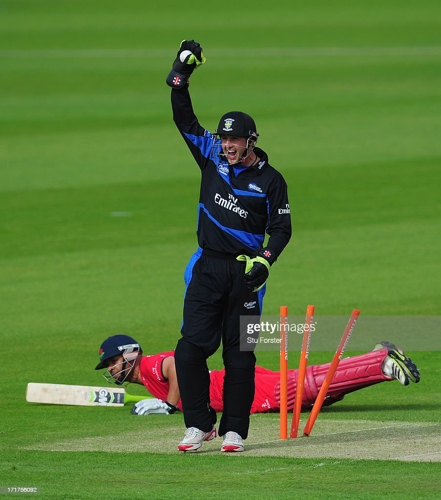 Durham wicketkeeper Phil Mustard appeals in vain for the run out of Lancashire batsman Aswell Prince during the Friends Life T20 match between Durham...