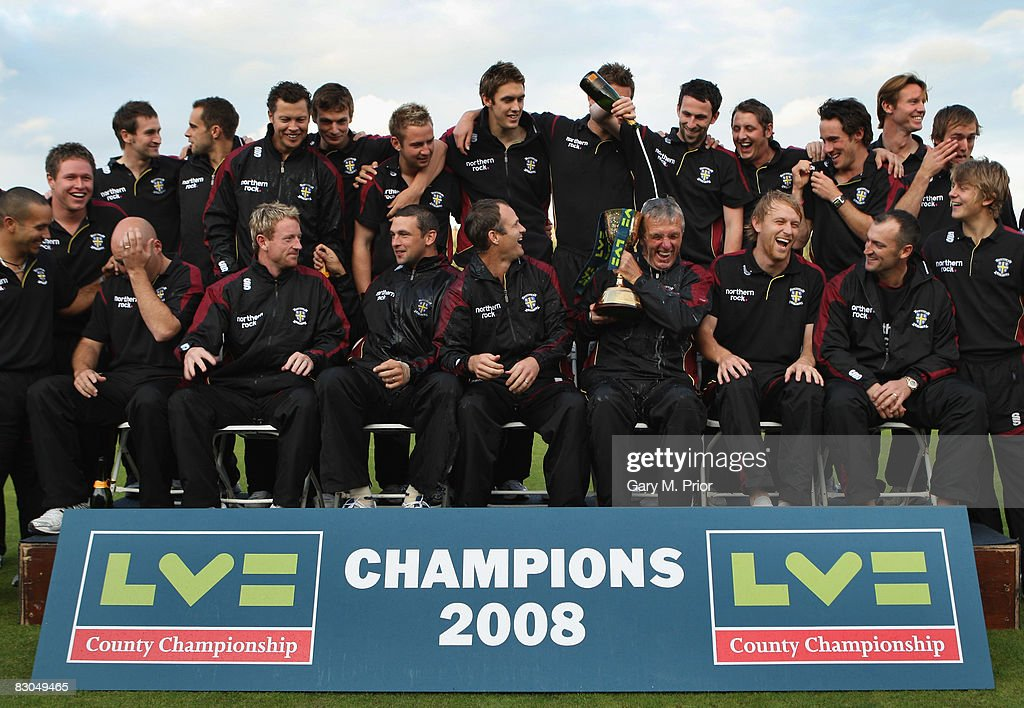 Durham's first team coach Geoff Cook gets covered with champagne during the Presentation of the LVE Championship trophy to the 2008 winners Durham at...