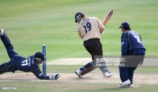 Durham's wicket keeper Phillip Mustard makes a diving catch to dismiss Surrey's Gary Wilson