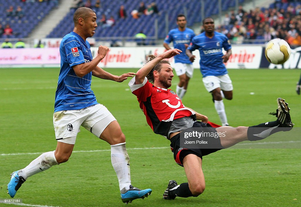 DuRi Cha of Freiburg and Christian Schulz of Hannover battle for the ball during the Bundesliga match between Hannover 96 and SC Freiburg at AWDArena...