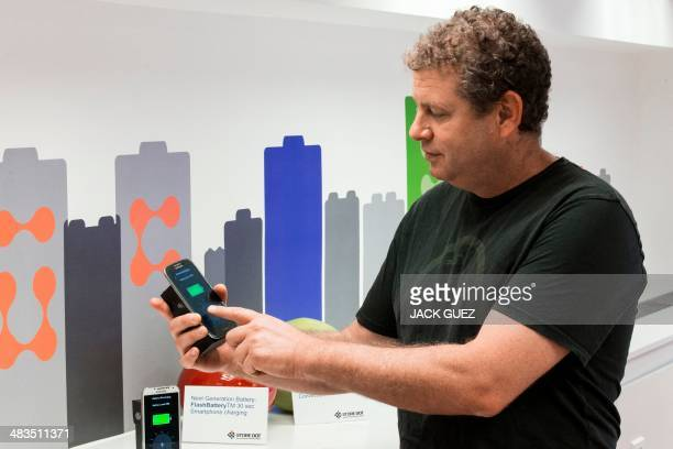 During a demonstartion a phone is charged during a demonstration by Israeli startup StoreDot of a bioorganic charger system which they are developing...