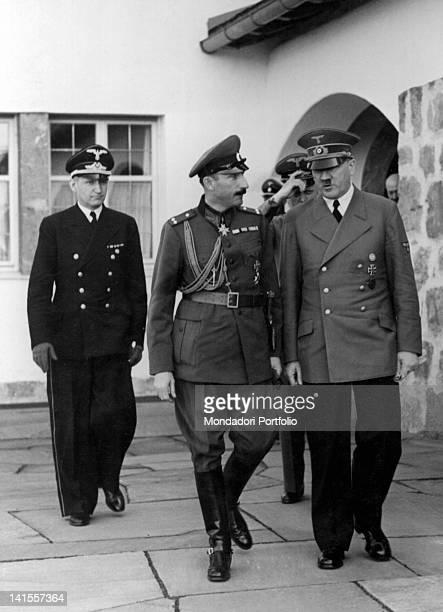 During a diplomatic meeting the Chancellor of the Third Reich Adolf Hitler walking beside Boris III Tsar of Bulgaria followed by the Foreign Minister...