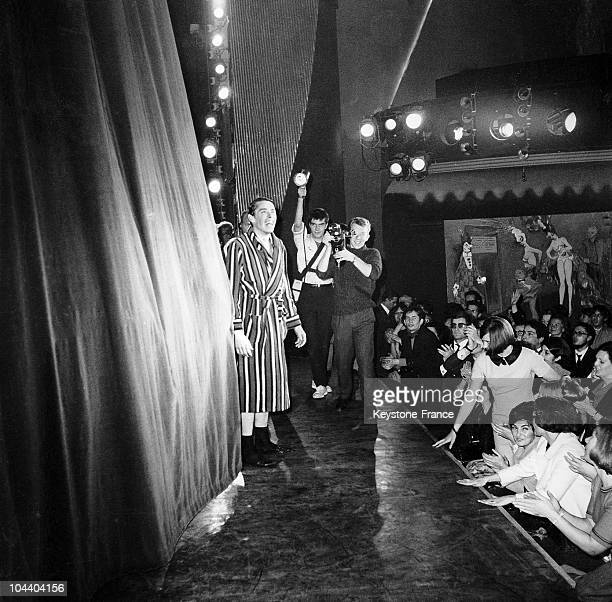 During a final concert in Paris the singercomposer Jacques BREL in dressing gown bids farewell to his fans Although he did not give in to demands for...