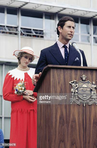 During a fiveday tour of Canada Prince Charles speaks to a crowd during visit to Edmonton Alberta while the Princess of Wales stands behind the podium