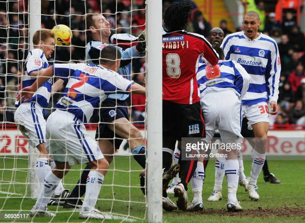 During a goal mouth scramble Marc Nygaard of QPR puts the ball past keeper Paul Jones to score during the Coca Cola Championship match between...