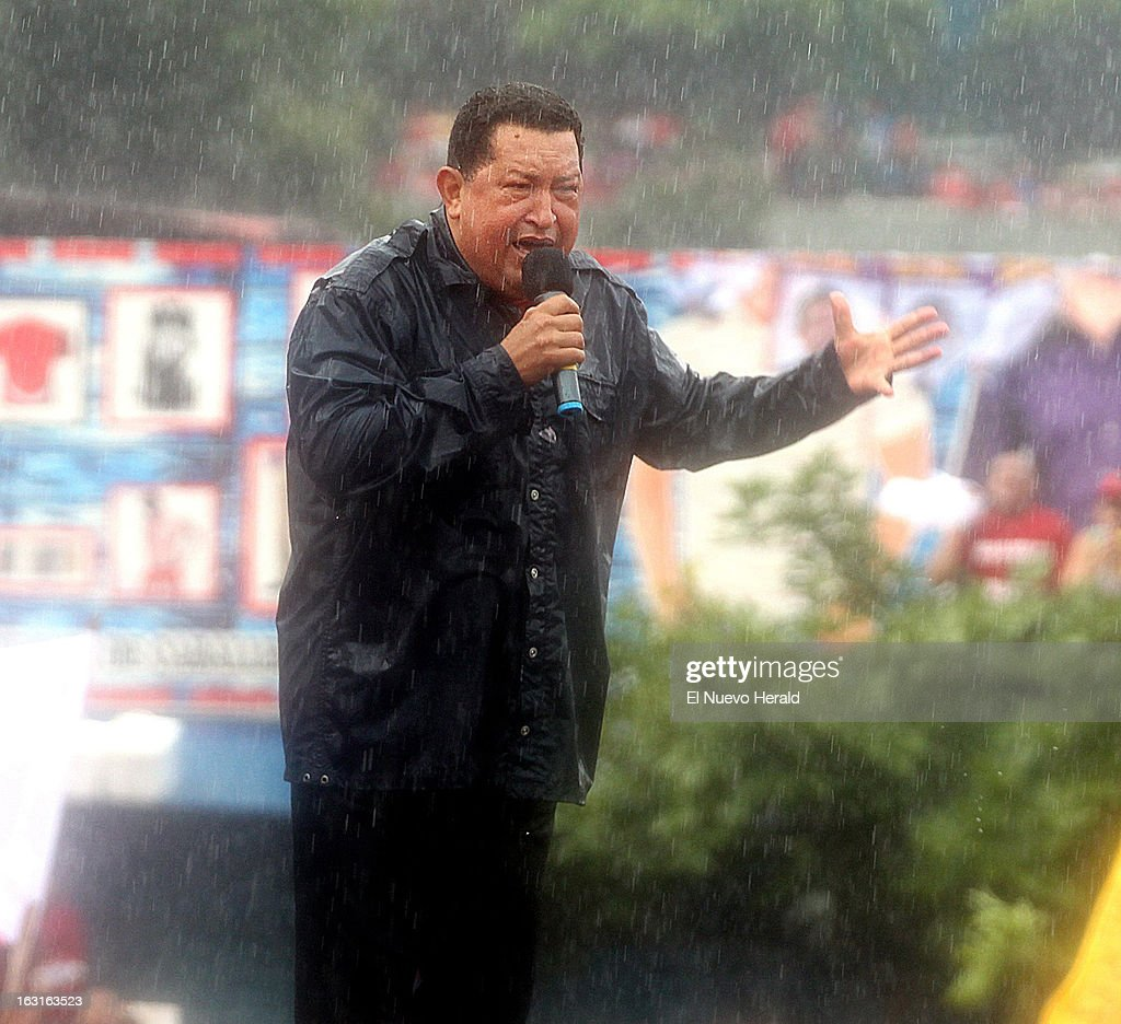 During a heavy rainstorm, Venezuelan President Hugo Chavez speaks at a campaign rally in Caracas, Venezuela, October 4, 2012. Chavez, the fiery populist who declared a socialist revolution in Venezuela, crusaded against U.S. influence and championed a leftist revival across Latin America, died Tuesday, March 5, 2013, at age 58 after a nearly two-year bout with cancer.
