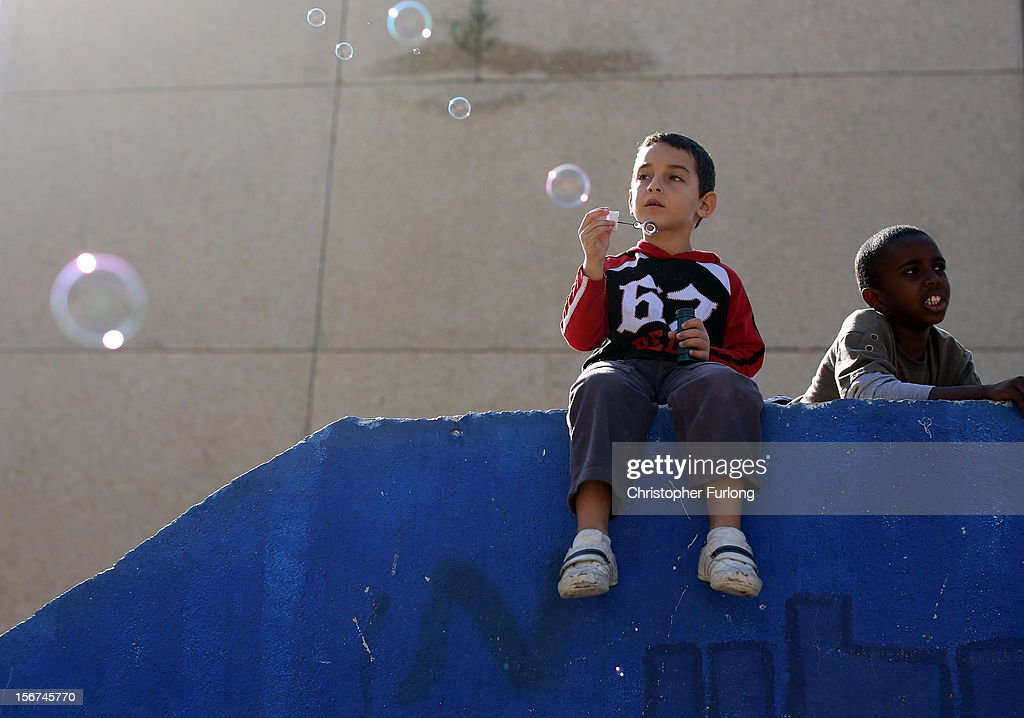 During a lull in militant rocket fire young boys play on the roof of a bomb shelter and blow soap bubbles on November 20, 2012 in Ashkelon, Israel. Hamas militants and Israel are continuing talks aimed at a ceasefire as the death toll in Gaza reaches over 100 with three Israelis also having been killed by rockets fired by Palestinian militants.