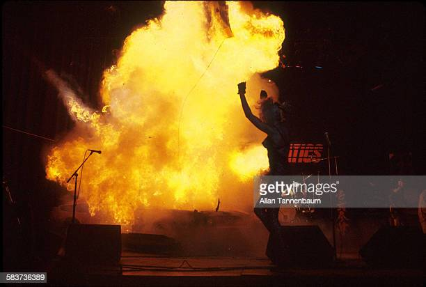 During a performance by the group the Plasmatics musician Wendy O Williams raises her arms as a Ford Mustang is detonated onstage the Calderone...