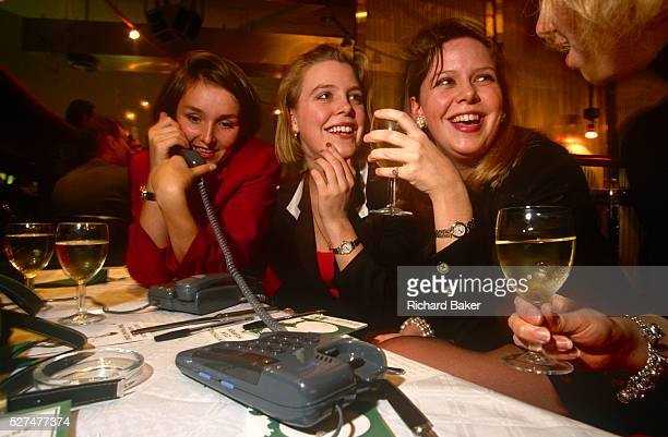 During a phone speeddating night in a City of London wine bar a group of young girls enjoy white wine their girlfriends' company but also the...