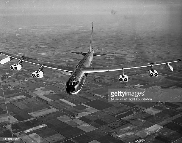 During a photo flight in 1958 a Boeing B52 Stratofortress bomber flies over the farmland of the midwestern United States | Location Midwestern United...