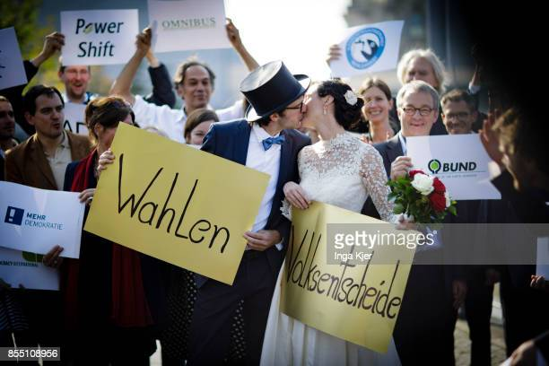 During a photoaction 'Democracy Wedding' the marriage between referendum and elections is being celebrated on September 28 2017 in Berlin Germany