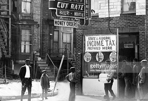 During a raciallymotivated riot in Baltimore Maryland a gang of AfricanAmerican youth loot a bar which also offered income tax preparation services...
