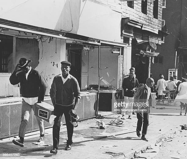 During a raciallymotivated riot in Baltimore Maryland AfricanAmerican youth team up to carry off a case of beer looted from a bar on Harford Avenue...