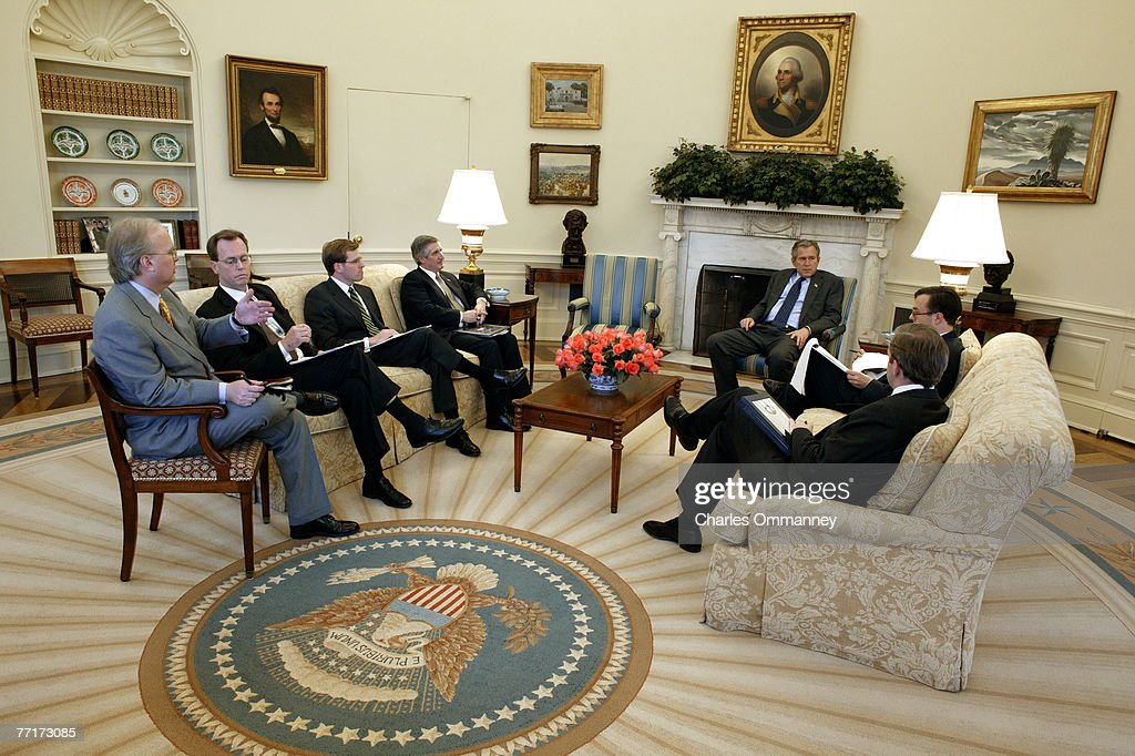 george bush oval office. during a speech writers meeting in the oval office of white house us president bush george