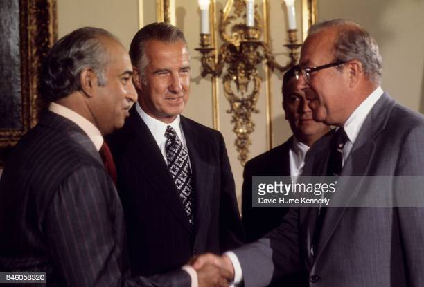 During a State visit President of Pakistan Zulfikar Ali Bhutto shakes hands with US Secretary of the Treasury George P Shultz watched by US Vice...