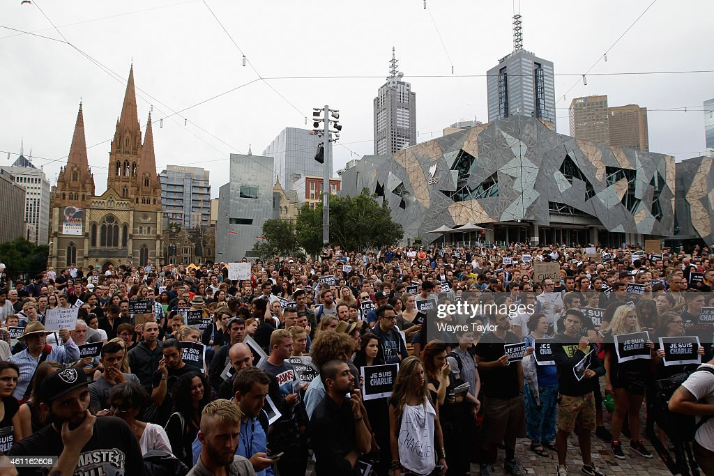 during a vigil for victims of the Paris massacre at Federation Square on January 8 2015 in Melbourne Australia Members of the French community...