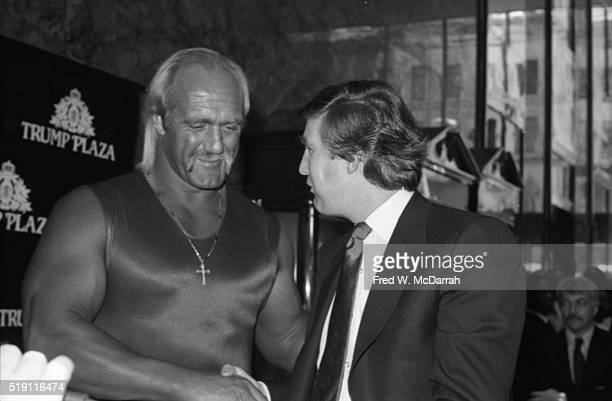 During a Wrestlemania event at the Trump Plaza American businessman Donald Trump poses with wrestlers Hulk Hogan and Andre the Giant Atlantic City...