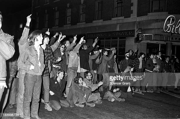 During an antiwar demonstration in Harvard Square a group of protestors jeer the police with obscene gestures Cambridge Massachussetts April 1970