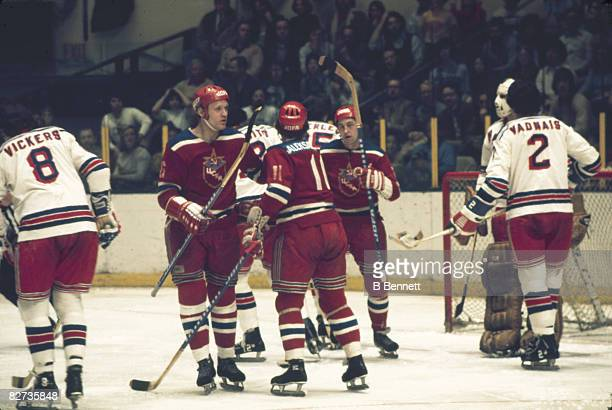 During an international exhibition game ice hockey players from CSKA Moscow celebrate a goal against the New York Rangers at Madison Square Garden...
