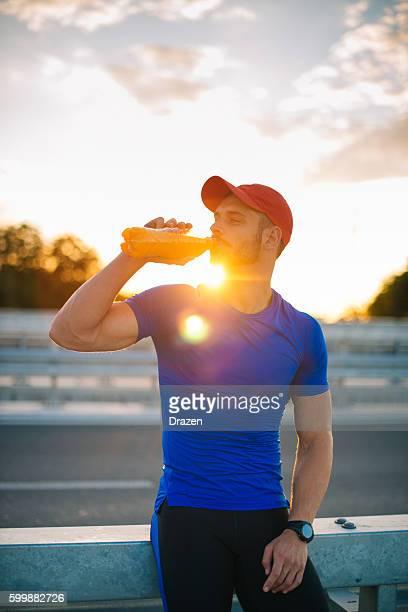 During break, sportsmen drink energy drinks