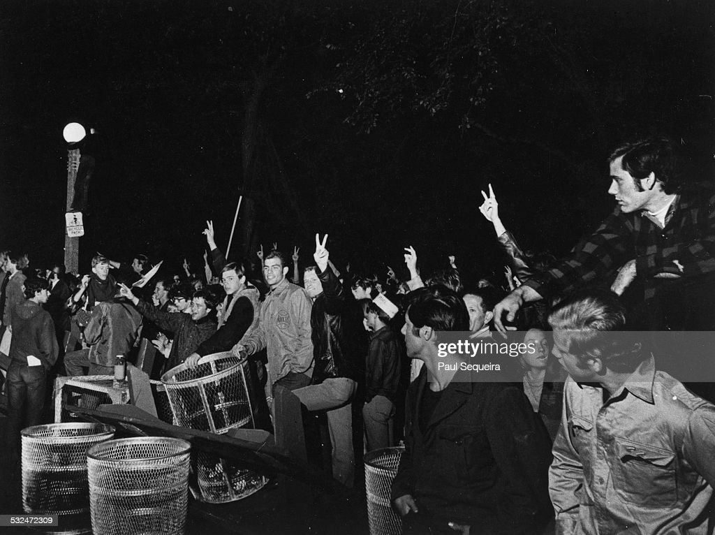 During demonstrations at the Democratic National Convention a group of protestors stand behind makeshift barricades at Lincoln Park Chicago Illinois...