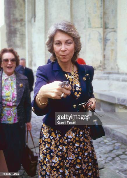 During her official trip to Romania the Spanish Queen Sofia catches a frog during her visit to the Monastery of Voronet Bucharest Romania