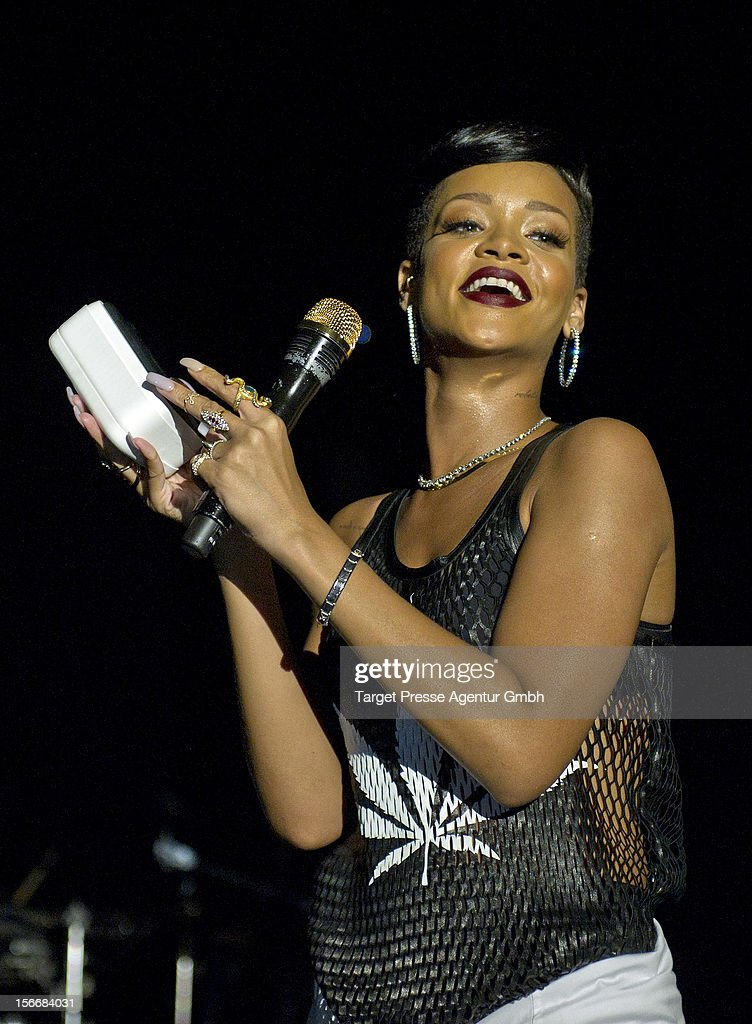 During her performance at her 777 Tour <a gi-track='captionPersonalityLinkClicked' href=/galleries/search?phrase=Rihanna&family=editorial&specificpeople=453439 ng-click='$event.stopPropagation()'>Rihanna</a> gives away a special HTC smartphone with an engraved 'R' to the fans on November 18, 2012 at E-Werk in Berlin, Germany.