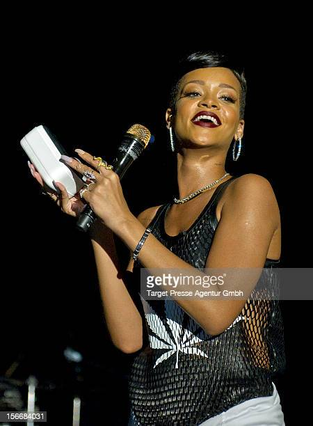 During her performance at her 777 Tour Rihanna gives away a special HTC smartphone with an engraved 'R' to the fans on November 18 2012 at EWerk in...
