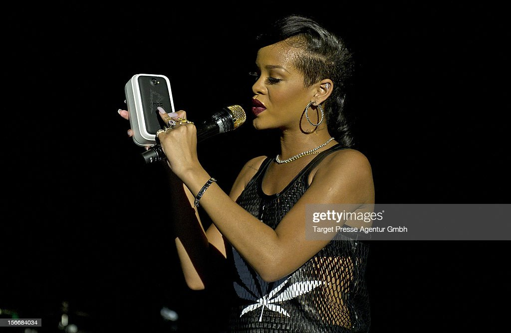 During her performance at her 777 Tour Rihanna gives away a special HTC smartphone with an engraved 'R' to the fans on November 18, 2012 at E-Werk in Berlin, Germany.