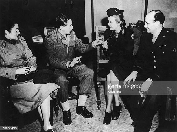 During her wartime service as a Red Cross nurse British actress Madeleine Carroll shows off her dog tags to journalists at a press conference in...