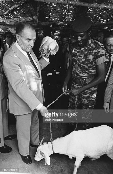 During his official visit to Burkina Faso French President Francois Mitterrand visits a local market with Burkina Faso President Thomas Sankara