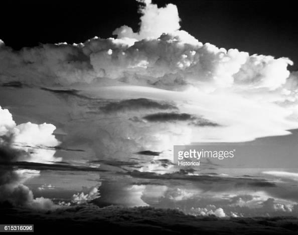 During Operation IVY the cap from the mushroom cloud of nuclear bomb 'Ivy Mike' spreads miles out from the center on the impact site The smoke climbs...