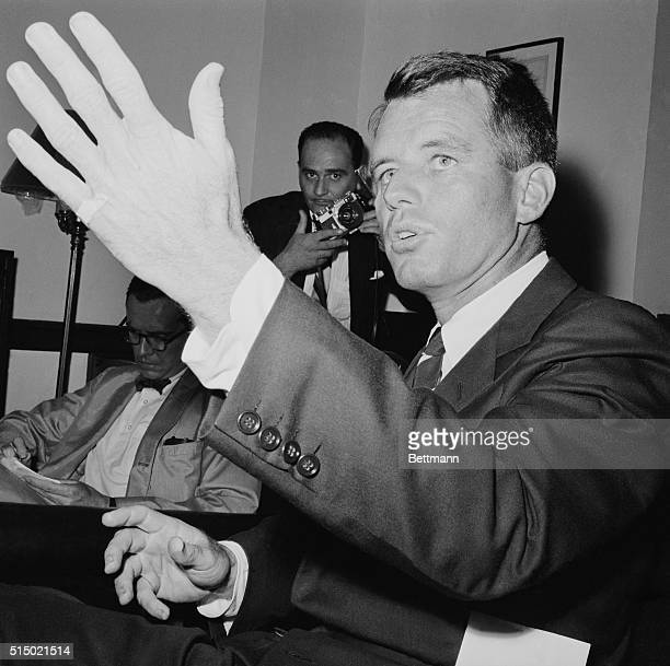 During press conference here Attorney General Robert F Kennedy tells the newsmen that he blames materialism of the American people for the prevalence...