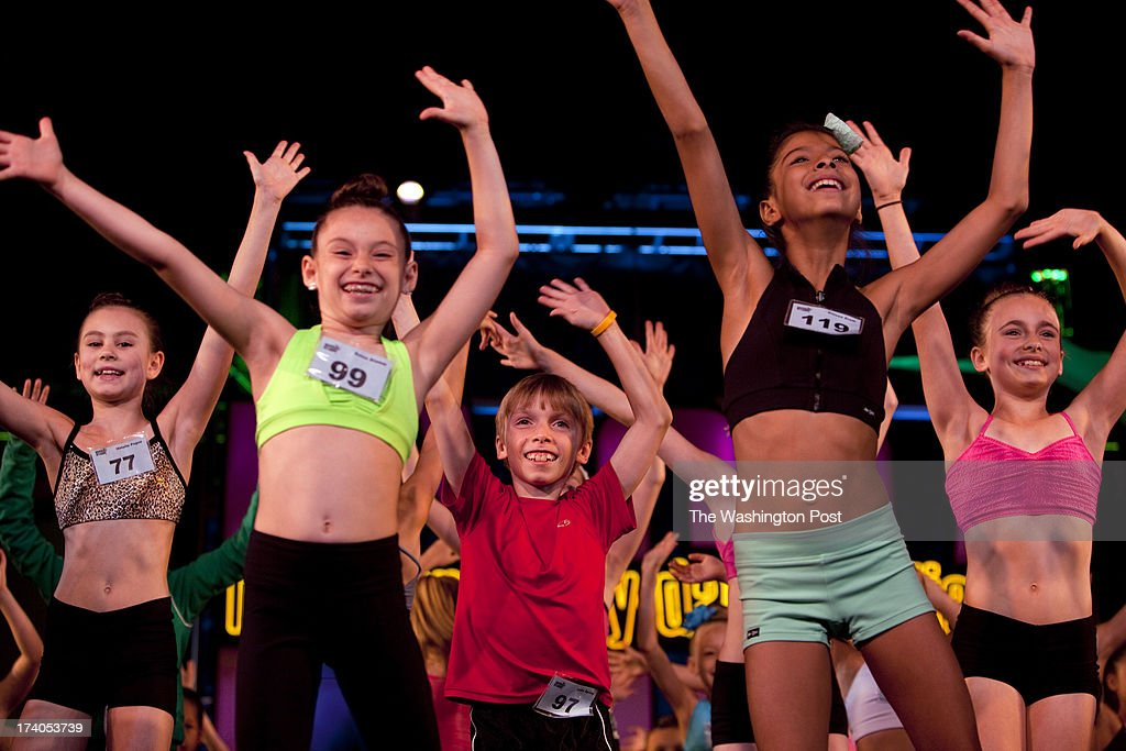 During rehearsals for the Junior Gala, Luke Spring, 10, center, dances alongside Natalie Pogue, 8, left, Reina Stamm, 8, and Anissa Zreik, 10, during the New York City Dance Alliance National Summer Workshop held at the Sheraton New York Times Square Hotel in New York, NY on July 05, 2013. Luke Spring, a dance prodigy from Studio Bleu Dance Center in Ashburn, VA, has performed on the Tonys, Ellen, So You Think You Can Dance and The Ford Gala. His sisters Cami Spring, 20, and Lucy Spring, 18, are both award winning dancers.