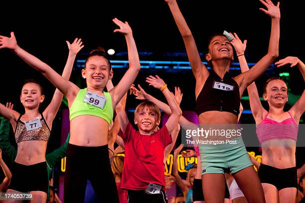 During rehearsals for the Junior Gala Luke Spring center dances alongside Natalie Pogue left Reina Stamm and Anissa Zreik during the New York City...