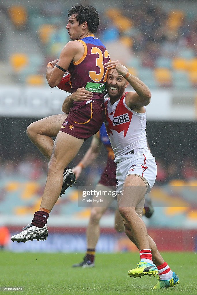 during Sam Mayes of the Lions takes a mark over Jarrad McVeigh of the Swans during the round six AFL match between the Brisbane Lions and the Sydney Swans at The Gabba on May 1, 2016 in Brisbane, Australia.