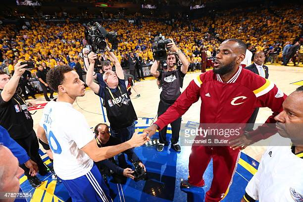 during Stephen Curry of the Golden State Warriors and LeBron James of the Cleveland Cavaliers shake hands before the start of Game Five of the 2015...